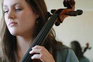 cello player practicing cello