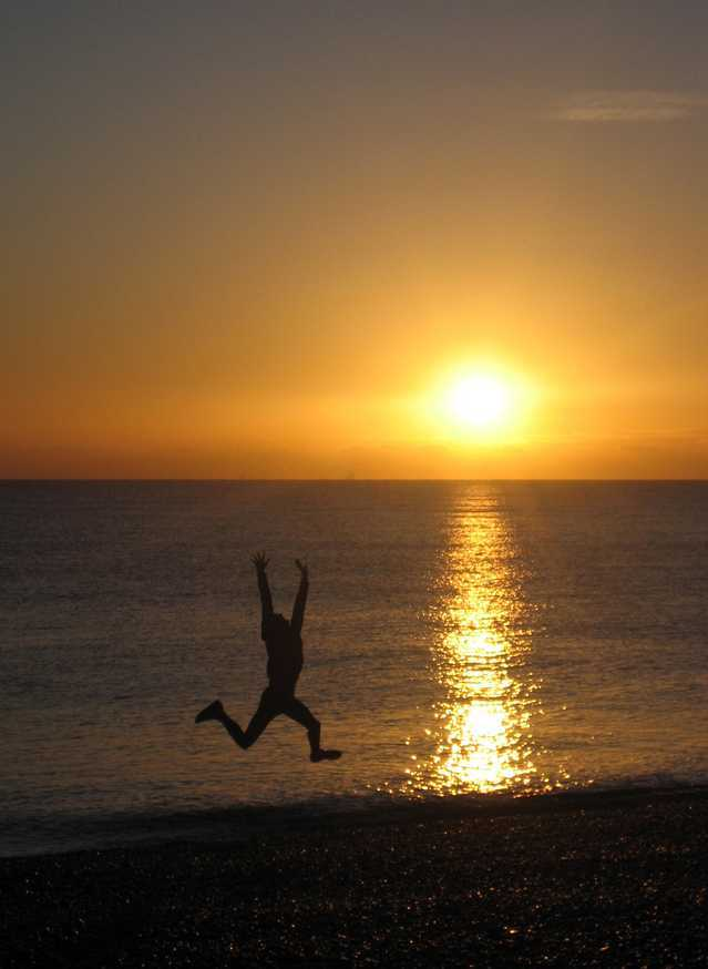 jumping person in sunset