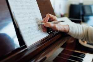 taking notes on sheet music