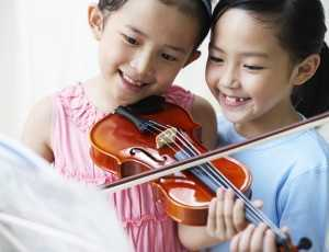 cute kids playing violin