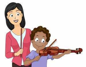 young boy receiving violin lesson
