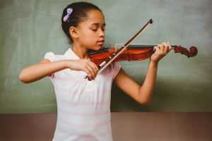 girl playing violin classromm