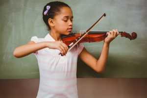 girl playing violin classromm