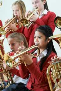 brass players in orchestra