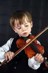cute child playing violin