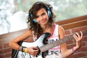 female guitarist with headphones