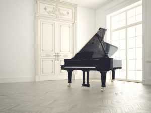 grand piano in white room isolated