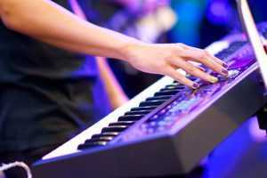 playing keyboard at rock concert