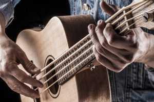 man playing bass ukulele