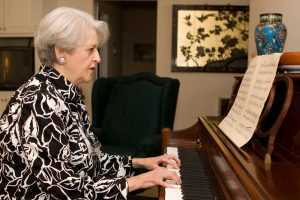 retired woman plays piano