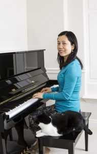 playing piano with a cat