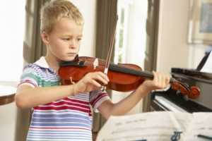 child practicing violin