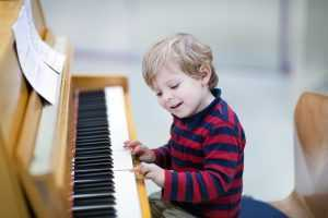 toddler playing piano