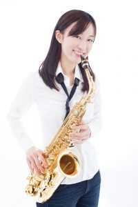 girl posing with saxophone