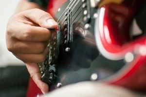 closeup of guitar player