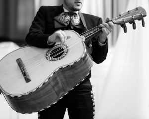 guitarron player in mariachi band