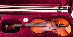 violin case with hygrometer