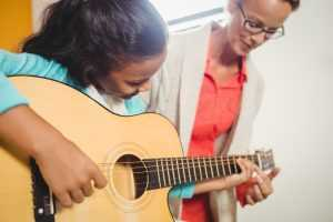 summer music lessons on guitar