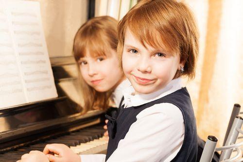 siblings piano lessons